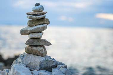 simplicity in investing Florida Advisor stacked beach rocks